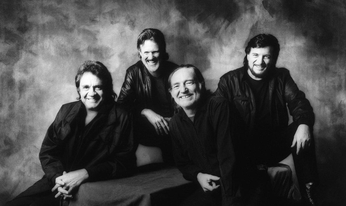 Photo of the four members of the band smiling