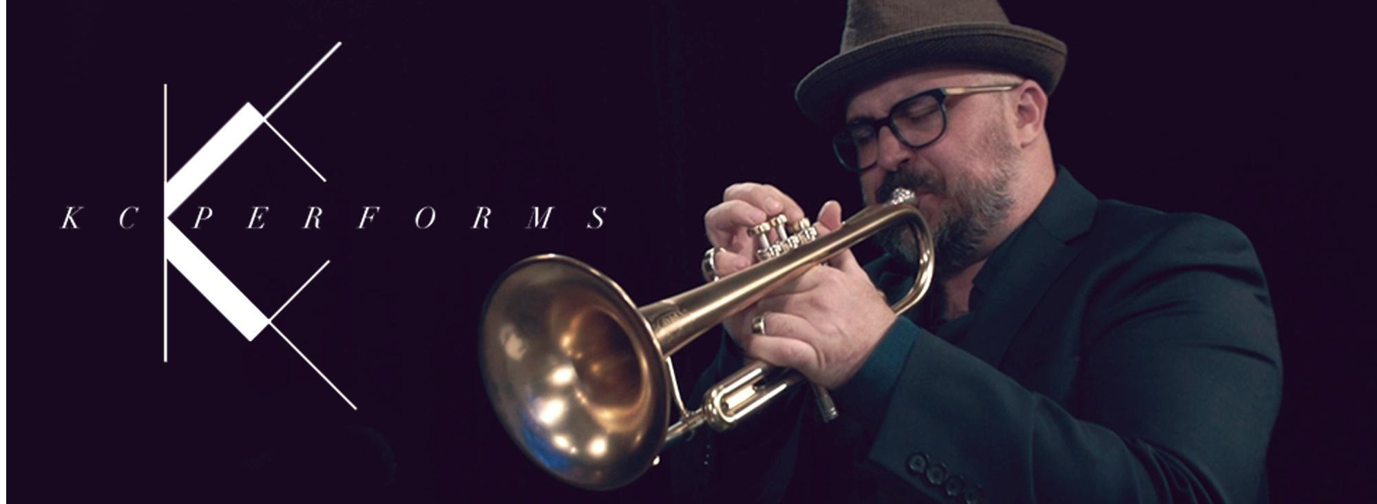 KC Performs logo, trumpeter playing