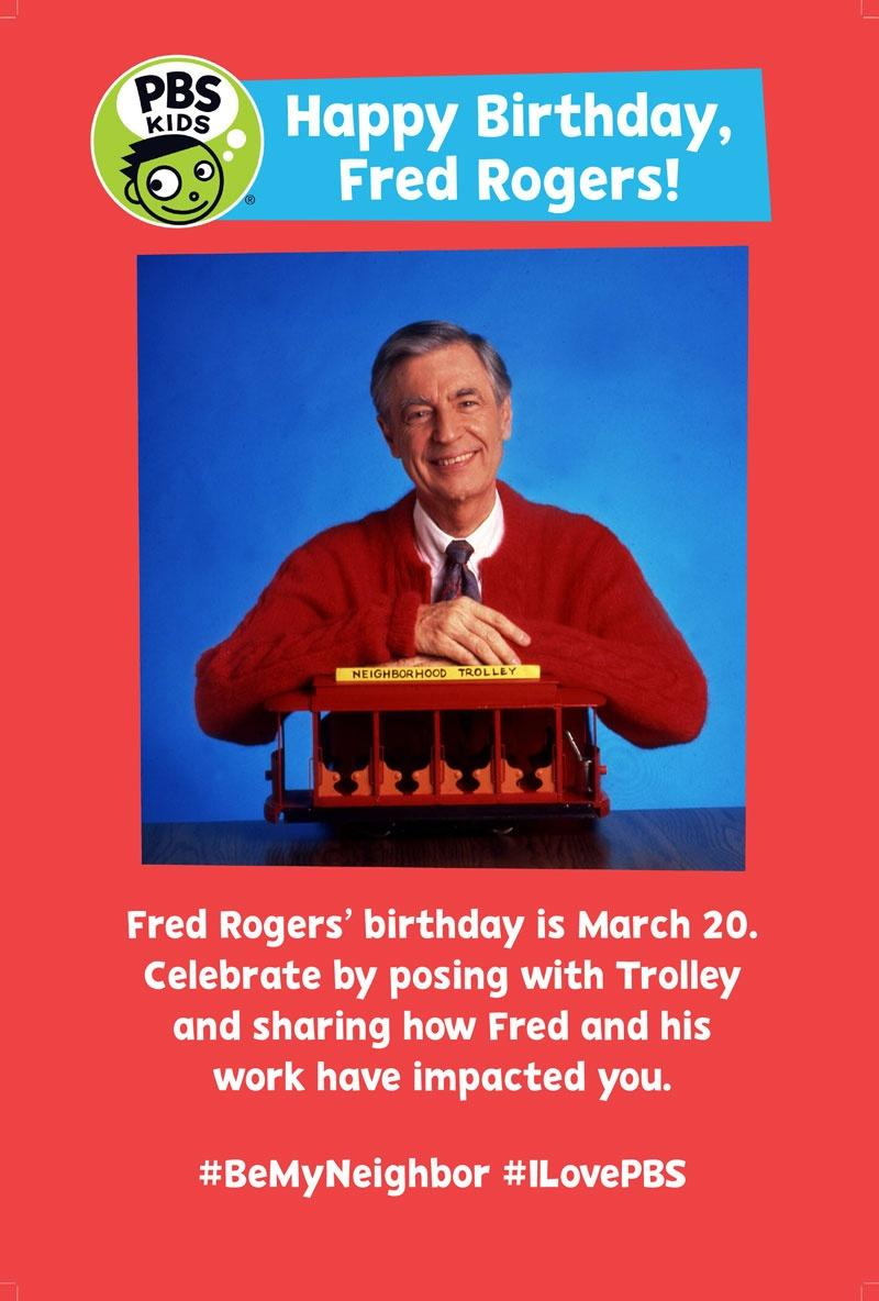 Photo of Mr. Rogers smiling with a small trolley car