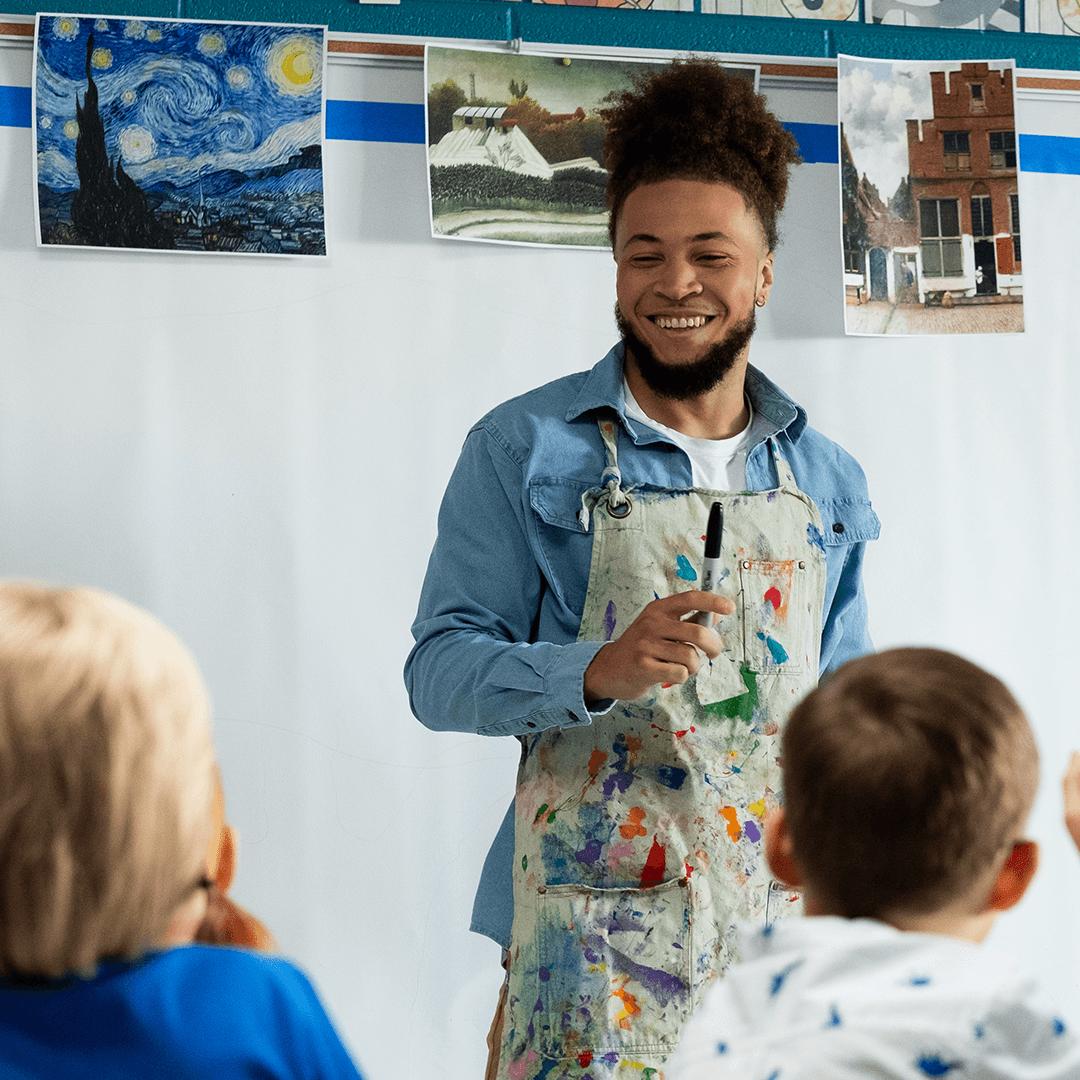 PBS Teachers' Lounge - Image of art teacher standing in front of class.