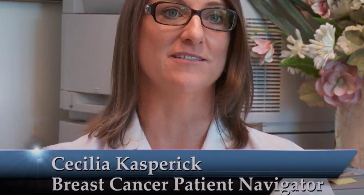 "woman looks into camera, captioned ""Cecilia Kasperick, Breast Cancer Patient Navigator"""