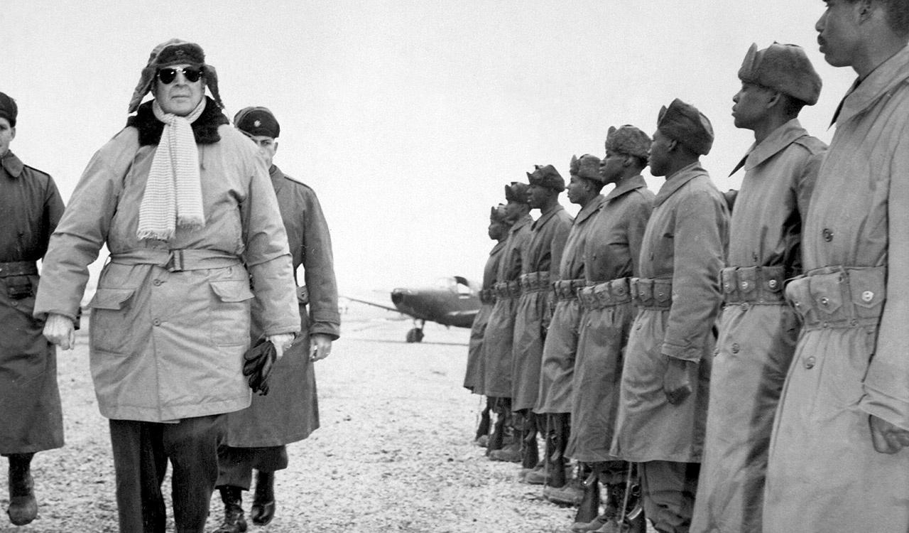 General of the Army Douglas MacArthur inspects troops of the 24th Infantry on his arrival at Kimpo airfield