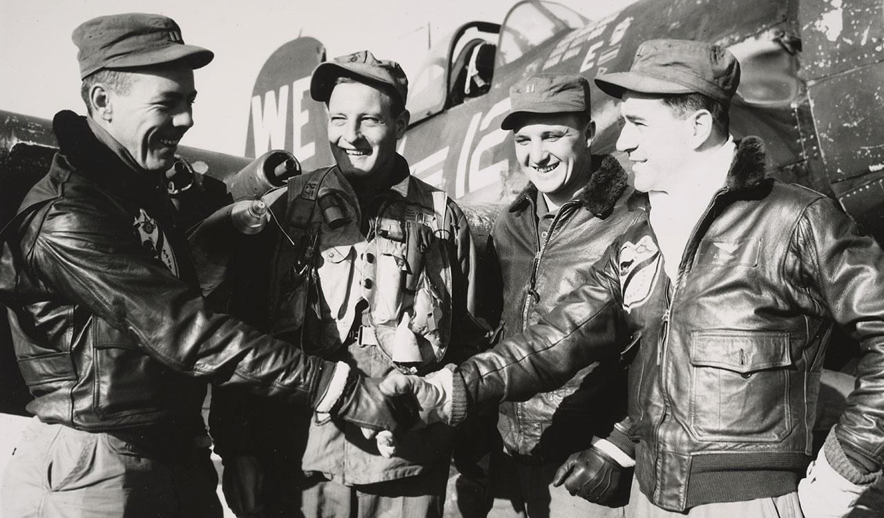 """Four Leatherneck pilots of the """"Black Sheep"""" squadron of the First Marine Aircraft Wing joined the """"Over one hundred club"""" when they tabulated their air strikes against the enemy"""