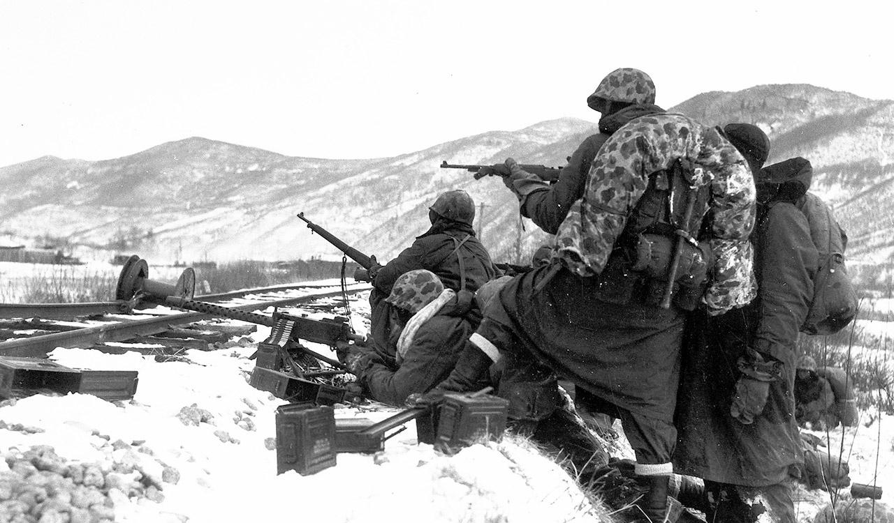 First Division Leathernecks are attacked by well entrenched Chinese Reds during the Division's heroic breakout from Chosin