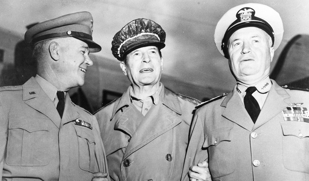 General Douglas MacArthur (center) greets Army Chief of Staff General J. Lawton Collins (left) and Chief of Naval Operations Admiral Forrest P. Sherman