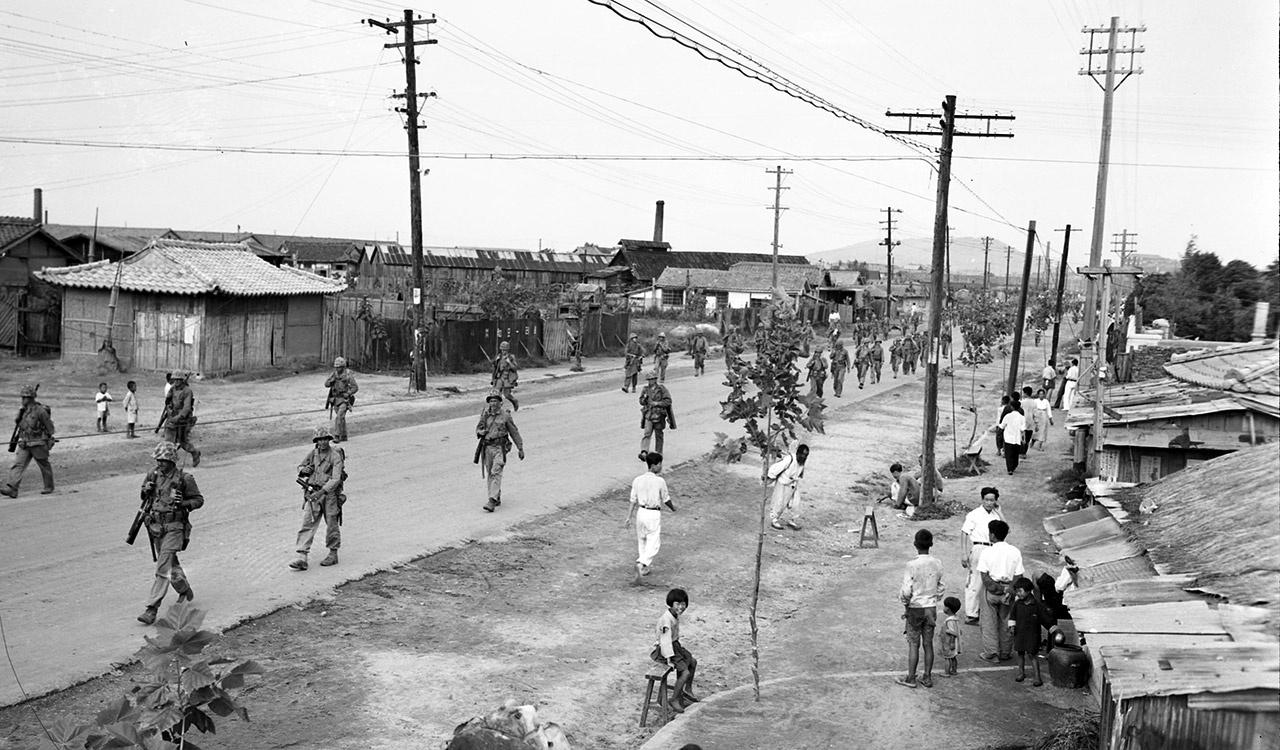 Inchon Residents Return to the Streets and Normal Way of Living as U.S. Marines March Through to Engage Enemy at Seoul