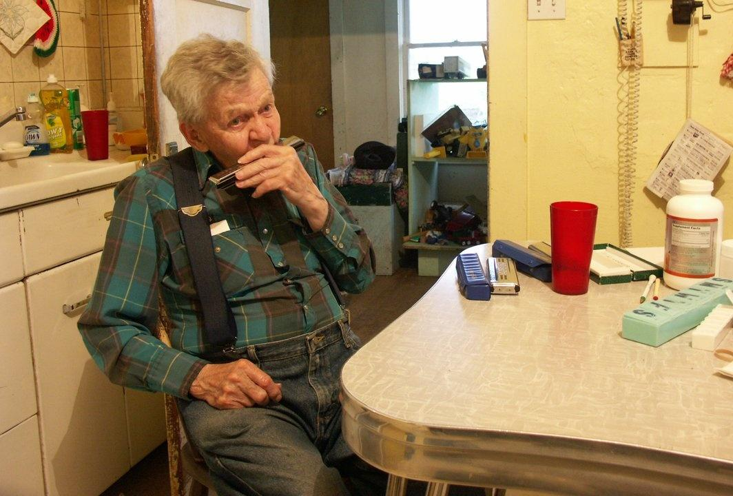 "Clarence ""Harmonica Man"" Rostad, retied rancher"