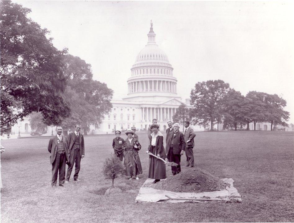 Congresswoman Rankin with shovel Belle Fligeman Arbor day 1917