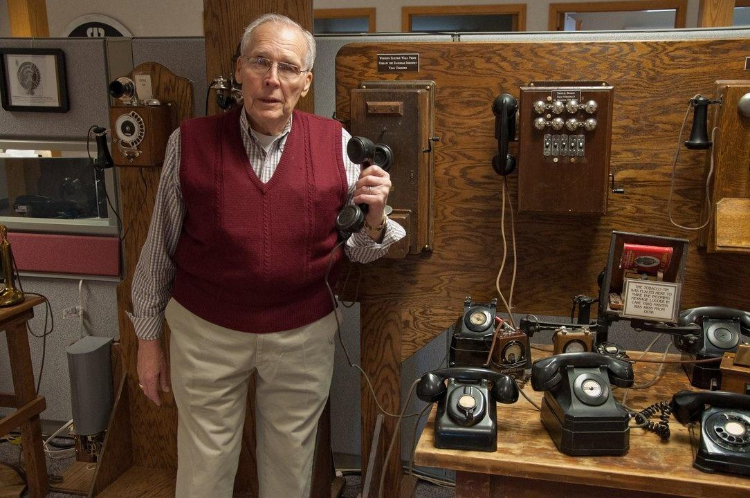 Frank Gebhardt with his collection of phones