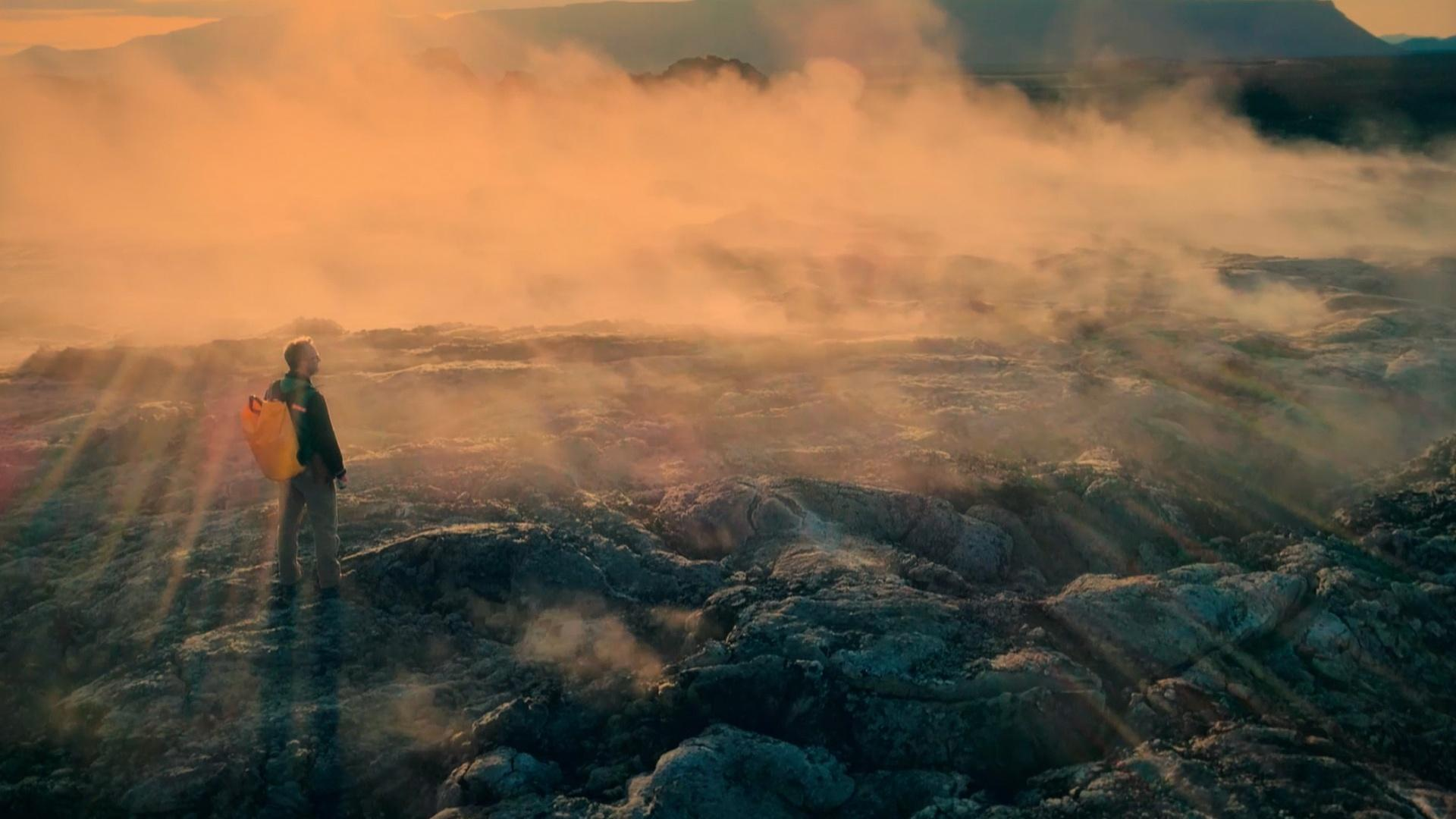 Geologist Stephen Mojzsis walks in Krafla Lava Fields. In this photo, taken in Northern Iceland, you see a field of lava that is so new that the rocks are still steaming.