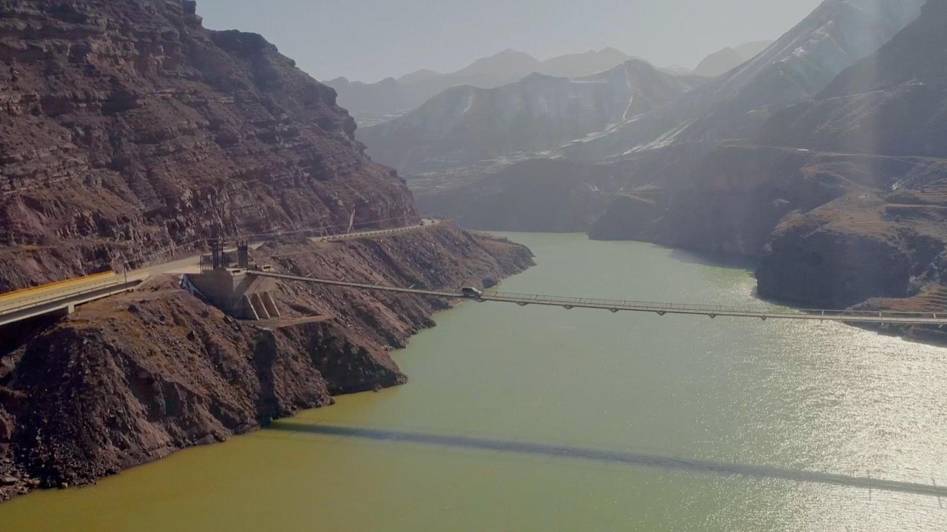 In Qinghai Province, China, Geoarcheologist Qinglong Wu crosses the Jishi Gorge by car.