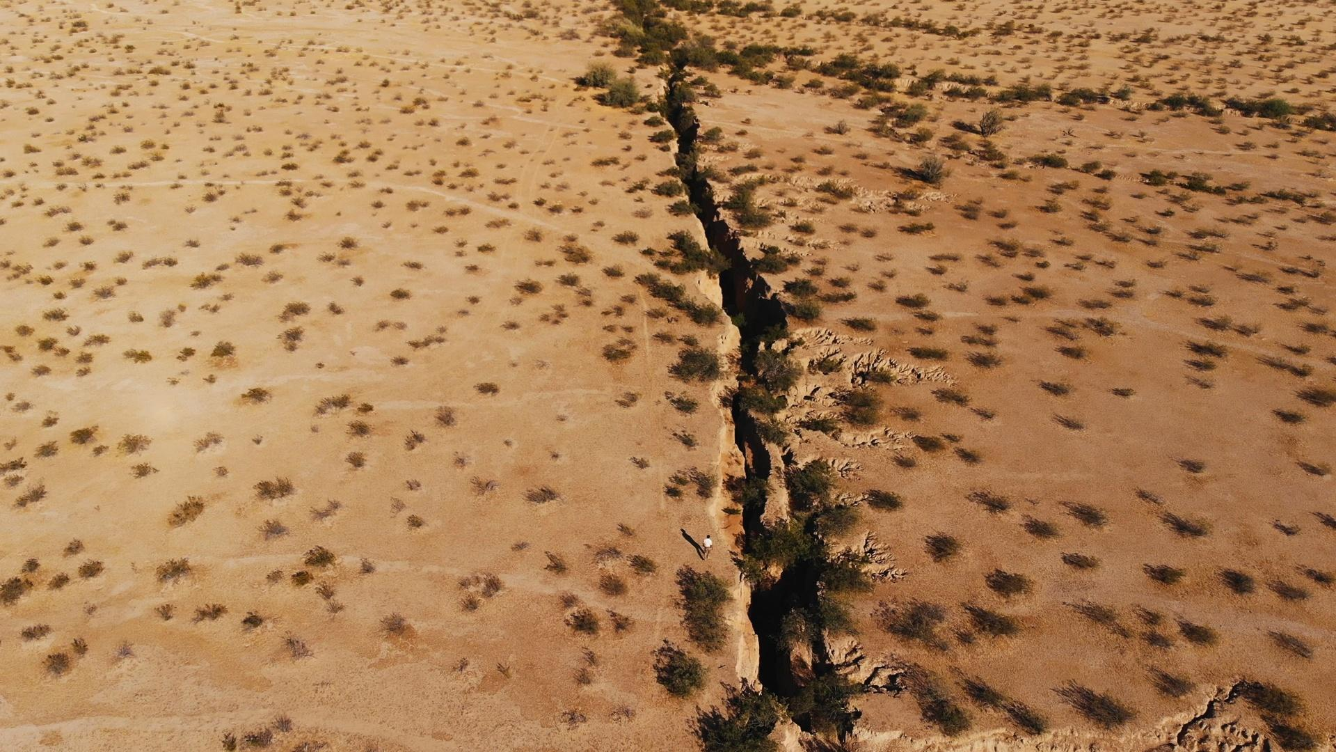 This crack is in Arizona, but it's just one of many cracks appearing on the surface of the earth due to our thirst for groundwater, water that comes from deep under the ground.
