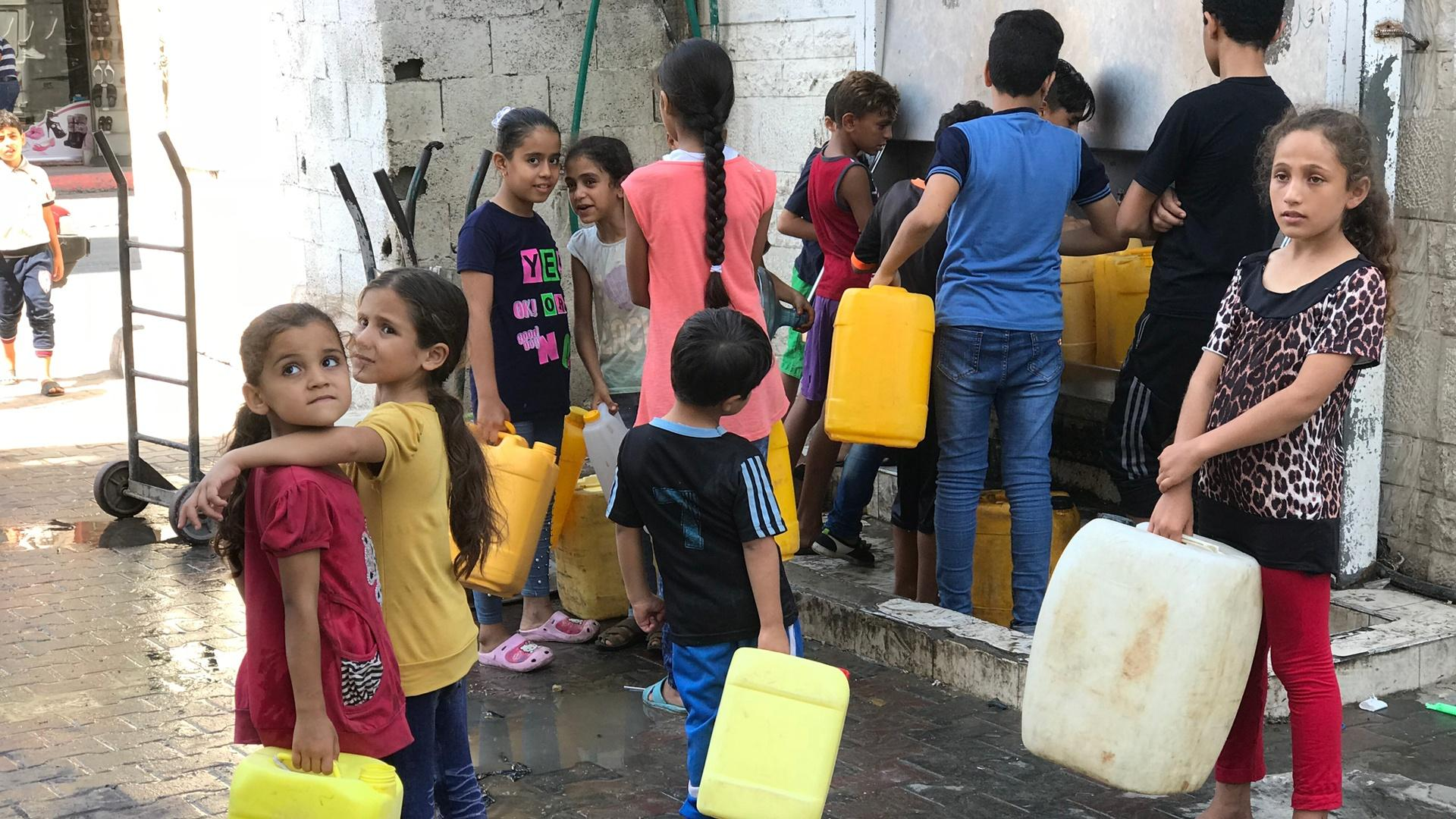 In Gaza, children line up to collect water. It's not unusual for Gaza residents to go a lifetime without ever meeting someone who has a 24-hour water supply.