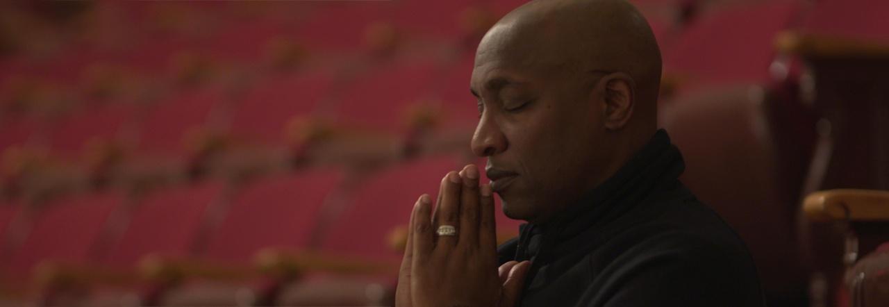 Michael Walrond prays