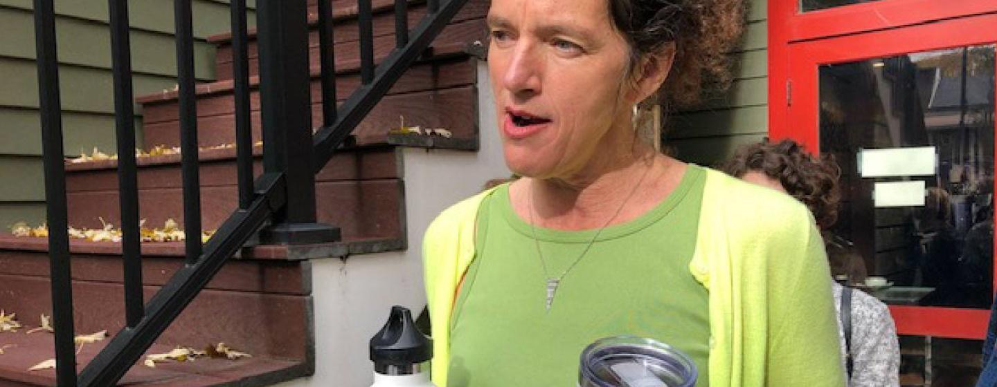 Woman Holds Reusable Beverage Containers