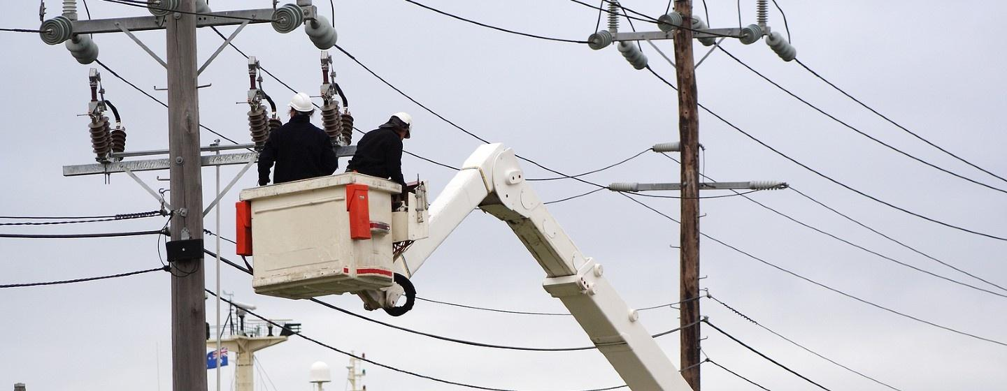 Utility workers tending to power lines