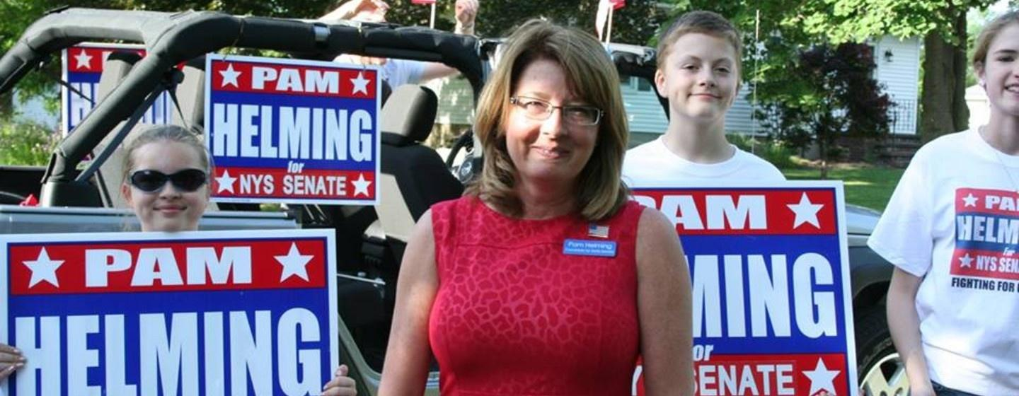 State Sen. Pamela Helming smiling with supporters in the background