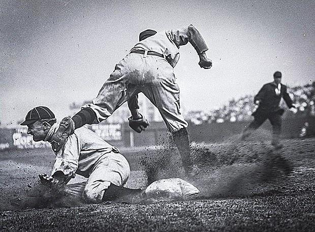 Ty Cobb stealing third base during the 1909 season.