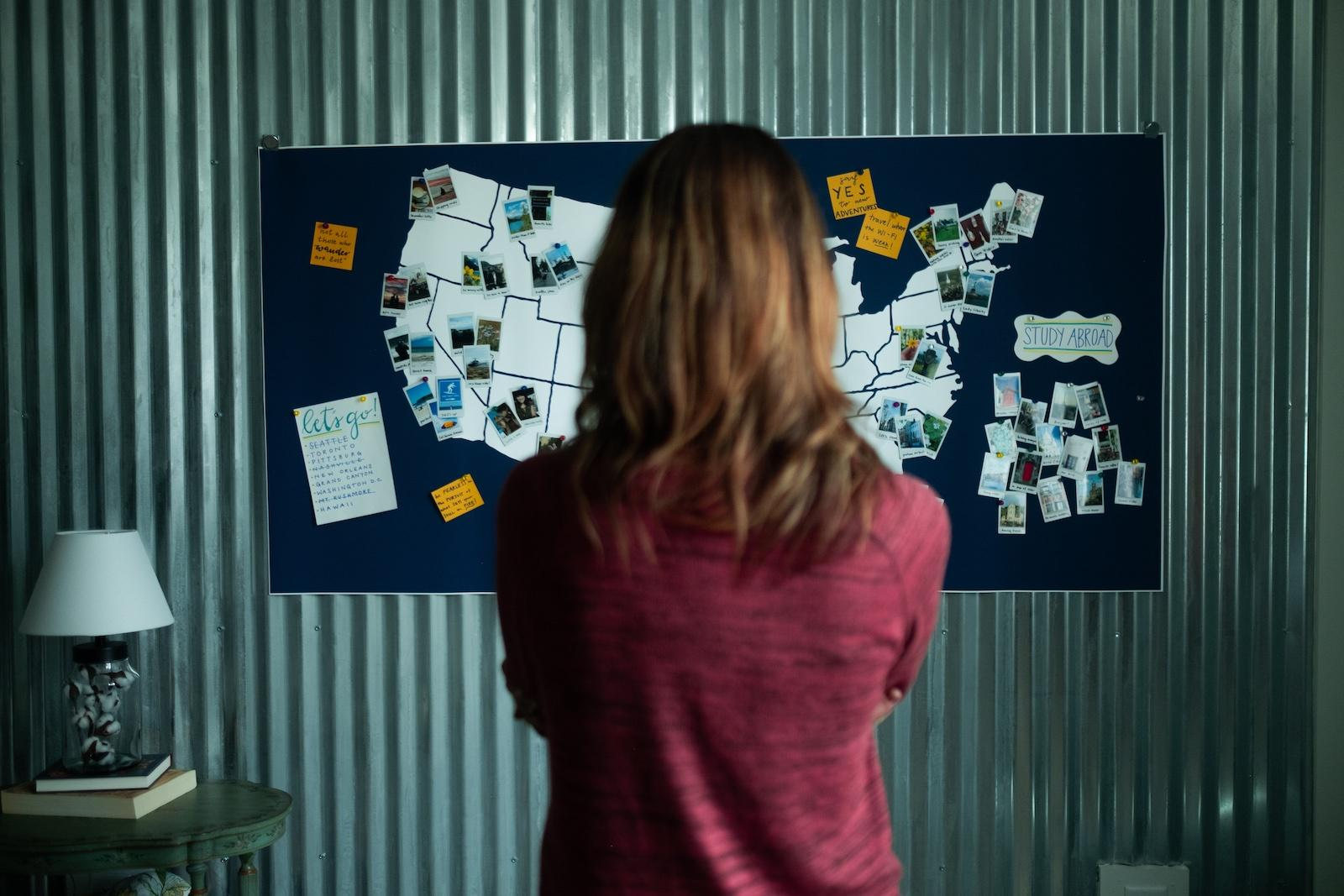 Woman stands before a map of the US