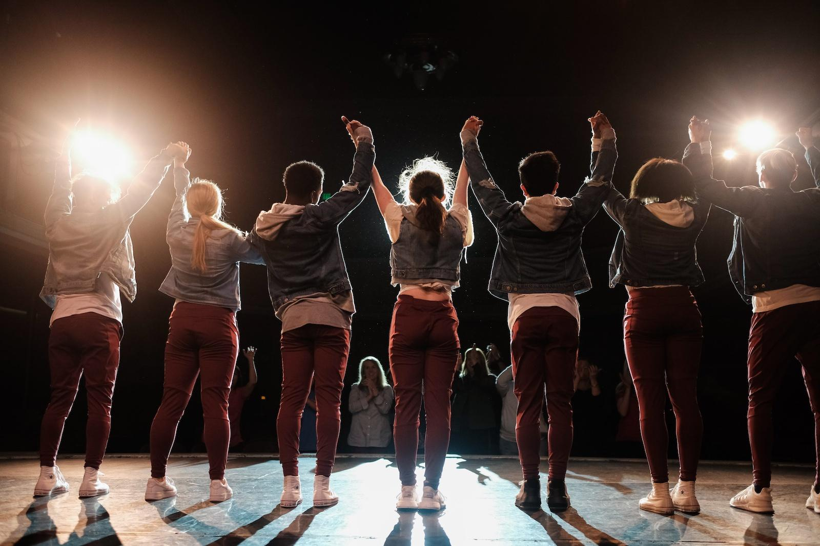 Row of performers taking a bow