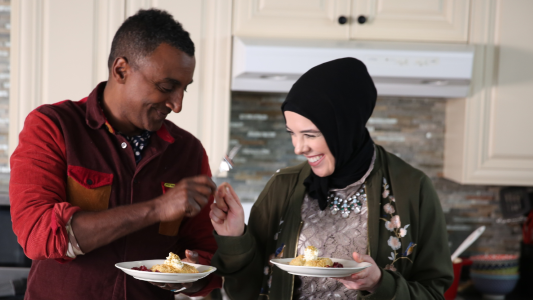 Detroit-based pastry chef Lena Sareini shares a fist bump with Marcus Samuelsson, the host of NO PASSPORT REQUIRED