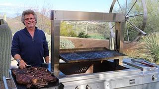 Steven at a meat smoker