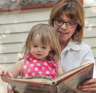 Photograph of mother reading a storybook to her daughter