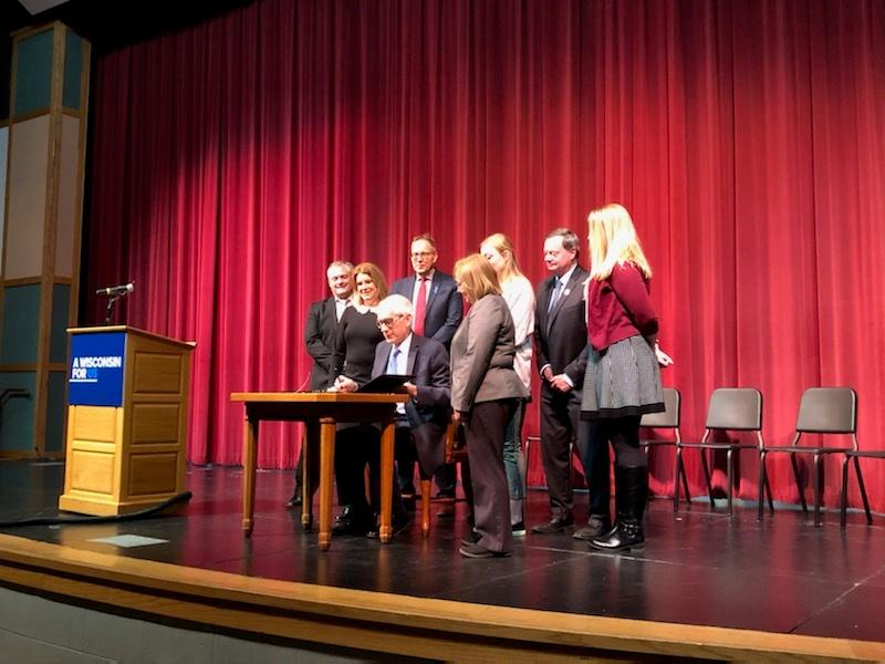 Governor Tony Evers signs peer-to-peer bill into law.