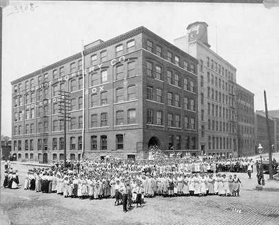 Photo of Holeproof Hosiery Building and Employees at 4th & St. Paul