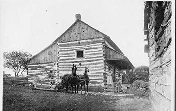 Photo of Log House with Horses for Early Settlers