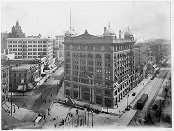 Photo of Germania Building at intersection of Water St and Wells St