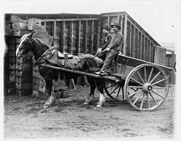 Photo of Two Men Atop Horse-Drawn Wagon at Northern Glass Works