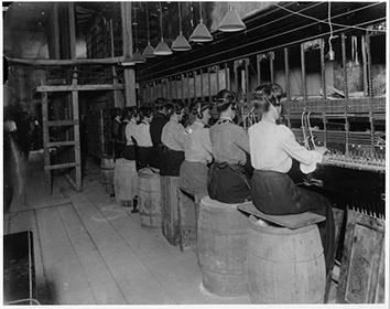 Photo of Women Telephone Operators Sitting Atop of Barrels