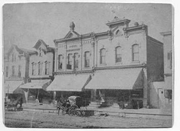 Photo of Third Street Storefronts with Horse in 1887