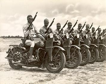 Photo of World War II Soldiers Riding Harley-Davidson Motorcycles