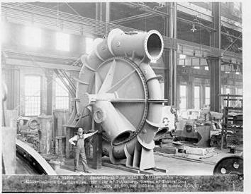 Photo of Centrifugel Pump with Man at Allis-Chalmers in 1907