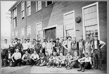 Photo of Employees Portrait in front of Pfister and Vogel Tannery
