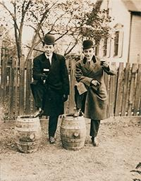 Photo of Dapper Brewery Men with Kegs and Beer