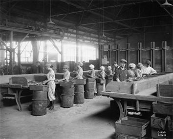 Photo of Women in Rex Chain Factory with Man Supervisor