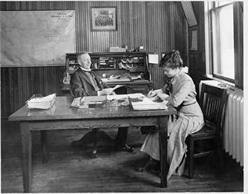 Photo of Early Office Scene with Woman Secretary