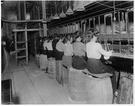 Photo of Telephone Company Where Women Operators Sit Atop Barrels