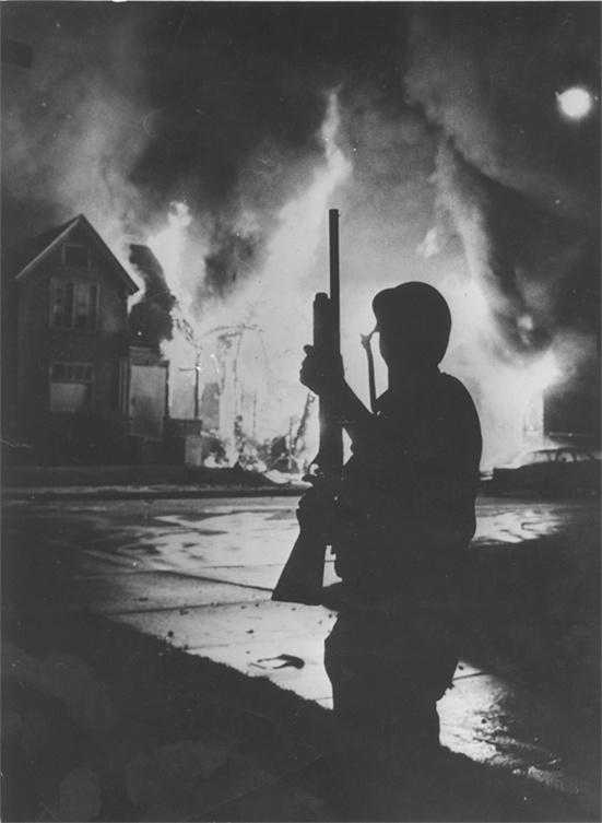 Photo of Policeman on 2nd & Center during Race Riot in July 1967
