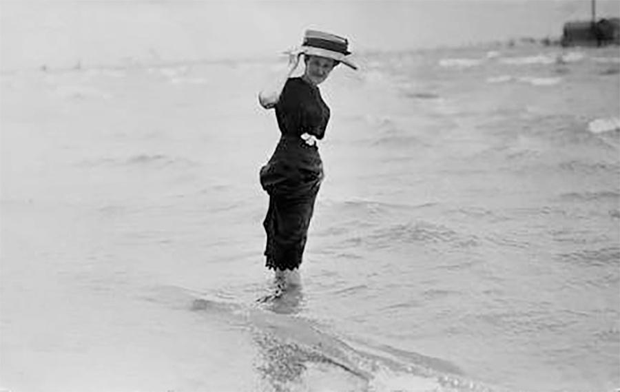 Photo of Woman in Large Hat Wading in Lake Michigan