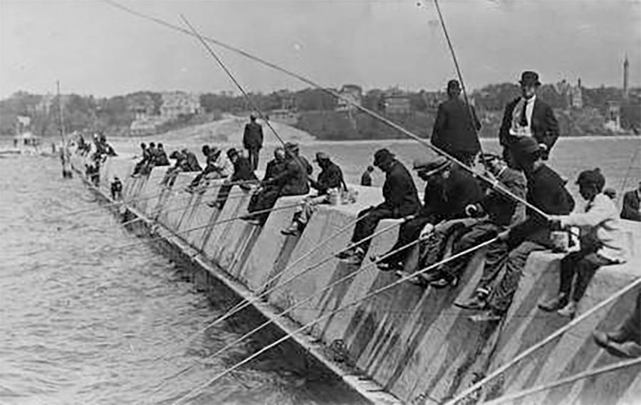 Photo of Men Fishing on Breakwater