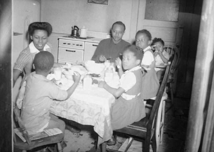Photo of African American Family Dining at Home
