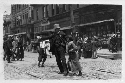 Photo of Woman Being Helped by Policeman Downtown