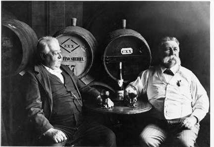 Photo of Two German Men Sampling Sherry