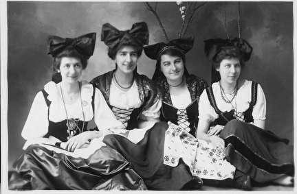 Photo of Four Women with Big Bows in their Hair