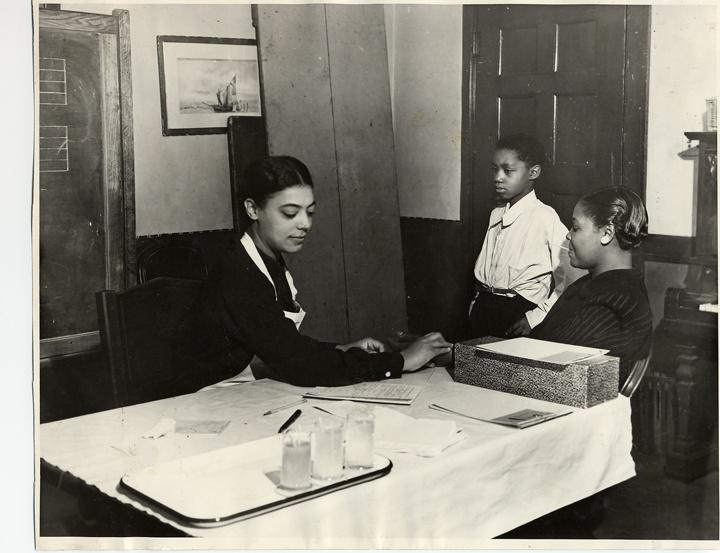 Photo of African American Woman and Children at Desk