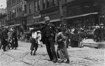 Photo of Woman and Policeman on Busy Downtown Street